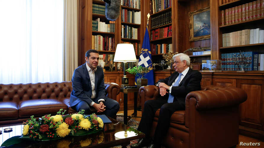 Greek Prime Minister Alexis Tsipras briefs Greek President Prokopis Pavlopoulos on developments on the name dispute with Macedonia, in Athens, Greece May 19, 2018.