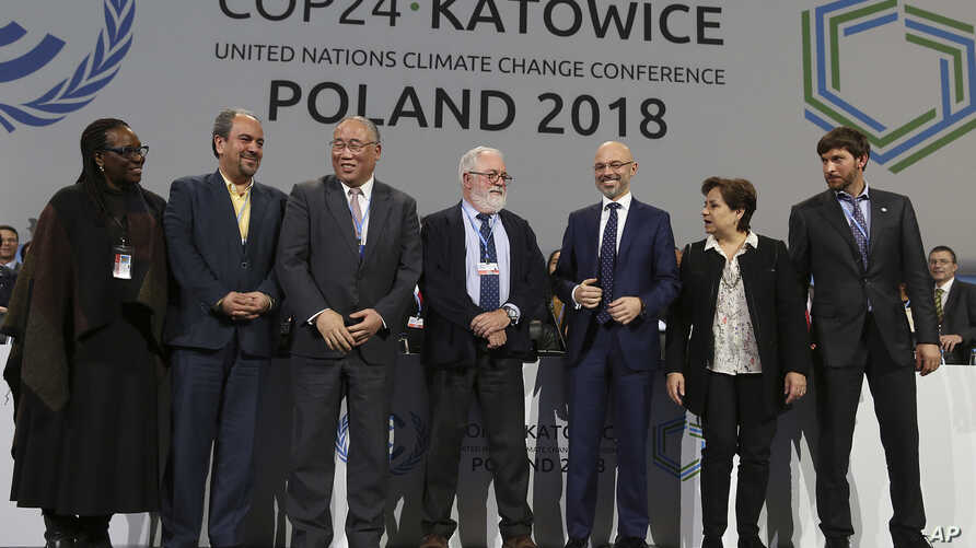 Heads of the delegations react at the end of the final session of the COP24 summit on climate change in Katowice, Poland, Dec. 15, 2018.