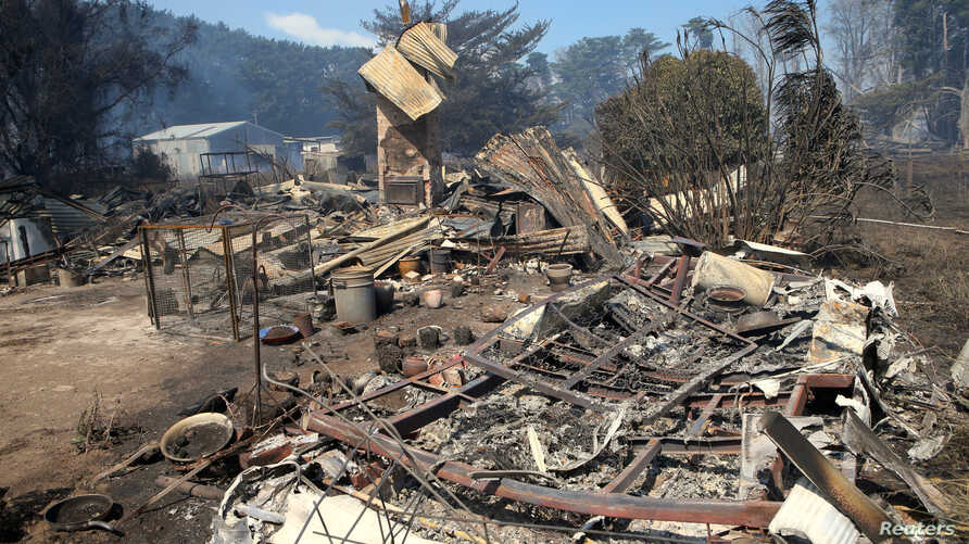 A house that has been destroyed by a bushfire can be seen near the town of Cobden, southwest of Melbourne in Australia, March 18, 2018.