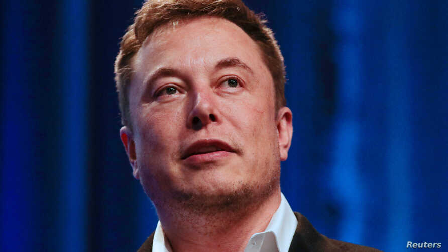 """FILE - Tesla and SpaceX CEO Elon Musk speaks during a """"fireside chat"""" at the National League of Cities (NLC) 2018 City Summit in Los Angeles, California, U.S., Nov. 8, 2018."""