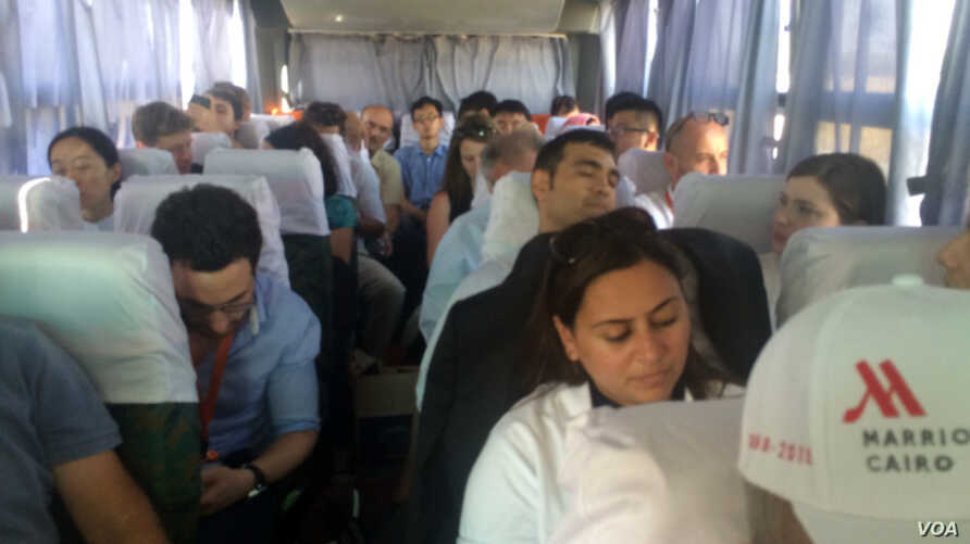 Most of the journalists that came to see the opening of the Suez Canal expansion made it to the party, but press badges were lost for this sad bunch, so they headed back to Cairo, Aug. 6, 2015. (Credit: Heather Murdock)
