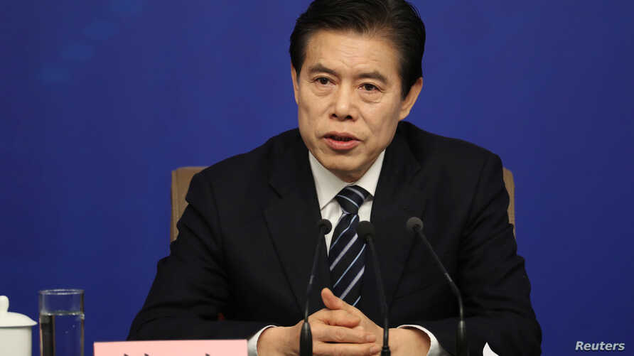 Chinese Commerce Minister Zhong Shan attends a news conference on the sidelines of the National People's Congress in Beijing, China, March 11, 2018.
