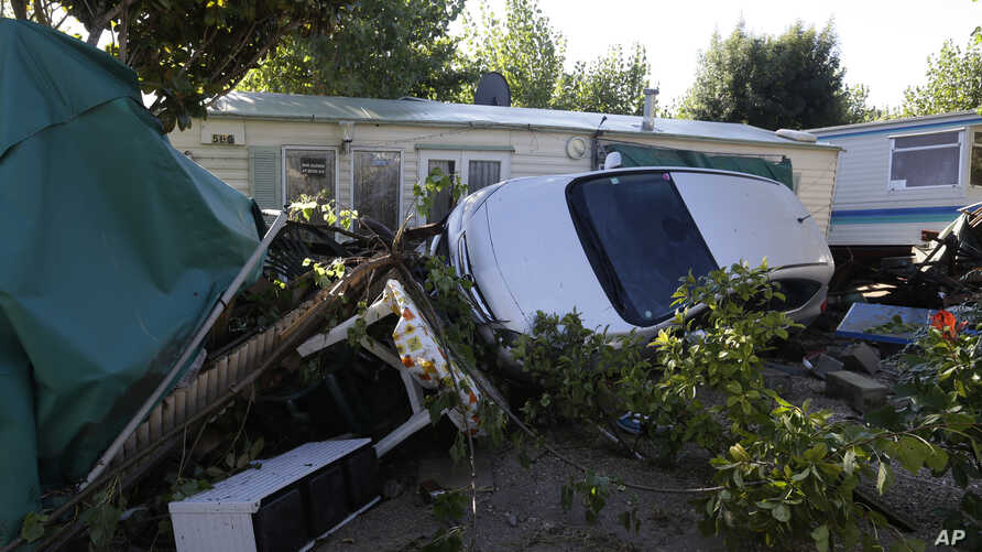 Debris and a damaged car are pictured in the campsite of Biot, near Cannes, southeastern France, Oct.4, 2015.