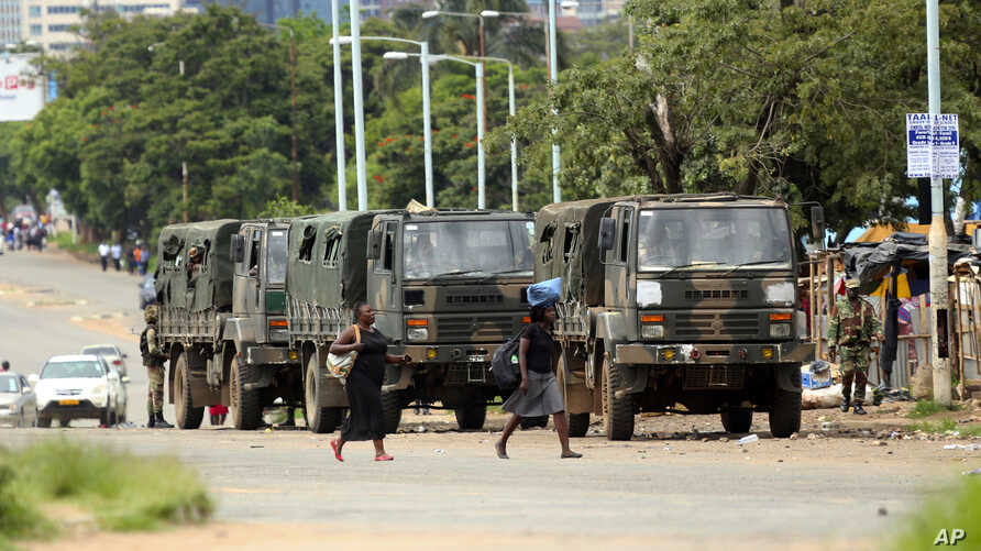 Zimbabwe soldiers are placed where police are clashing with protestors over fuel hikes in Harare, Jan. 14, 2019.