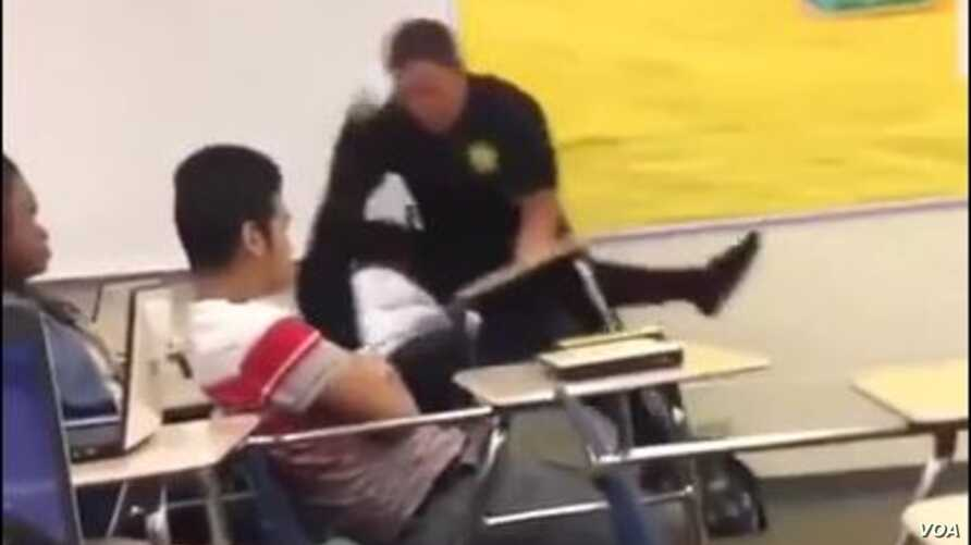 An image from video shows Spring Valley High School (Columbia, S.C., student resource officer Ben Fields, a senior deputy with the Richland County police department, using force to remove a female student from a classroom, Oct. 26, 2015.