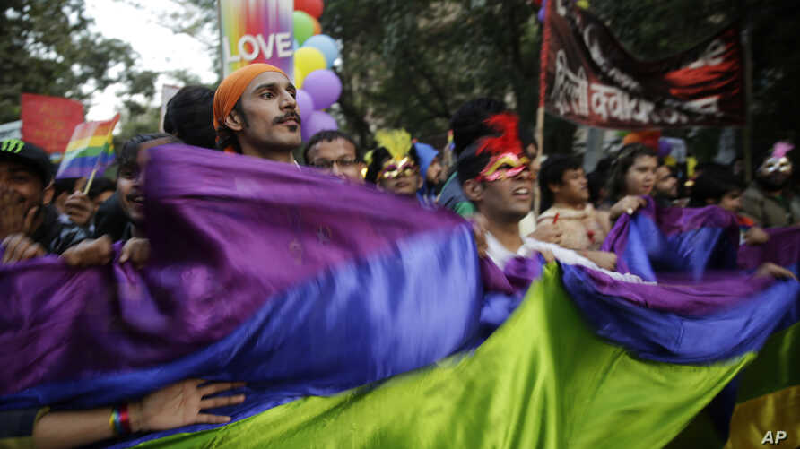 Indian gay rights activists and their supporters march during New Delhi's gay pride parade in New Delhi, Nov. 27, 2016.