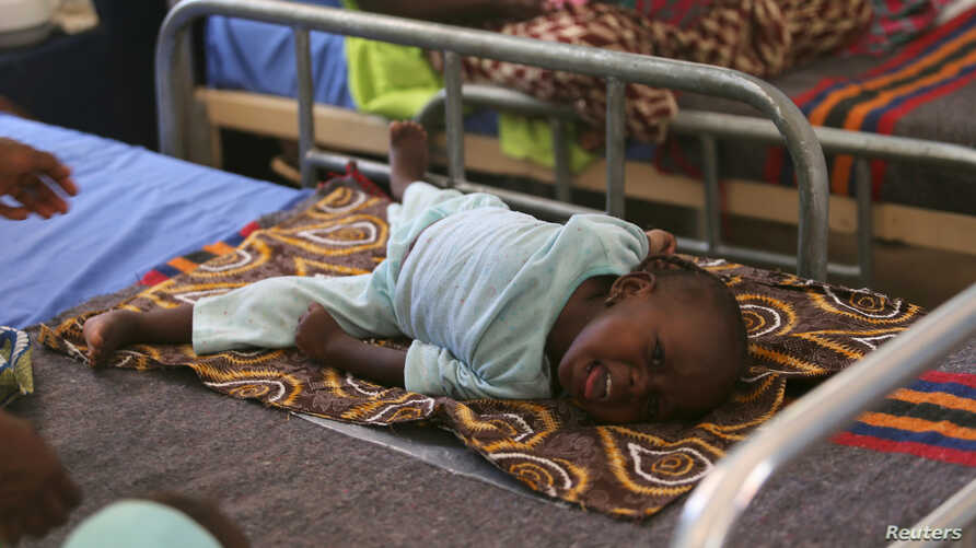 FILE - A child who sustained brain damage resulting from cerebral spinal meningitis is seen at the Save the Children stabilization ward in Maiduguri, Nigeria, Nov. 30, 2016.