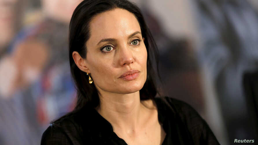 FILE - United Nations High Commissioner for Refugees (UNHCR) Special Envoy Angelina Jolie attends a news conference as she visits a Syrian and Iraqi refugee camp in the southern Turkish town of Midyat in Mardin province, Turkey, June 20, 2015.