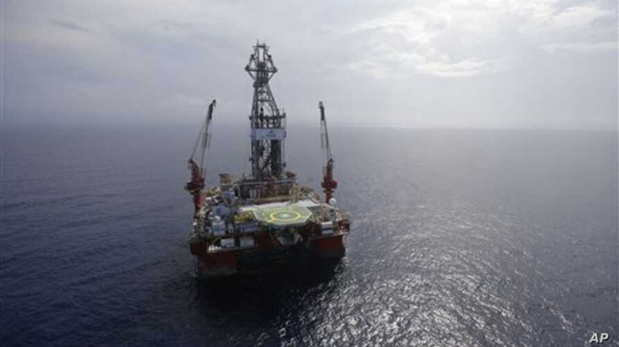The Centenario deep-water drilling platform stands off the coast of Veracruz, Mexico in the Gulf of Mexico, Friday, Nov. 22, 2013.