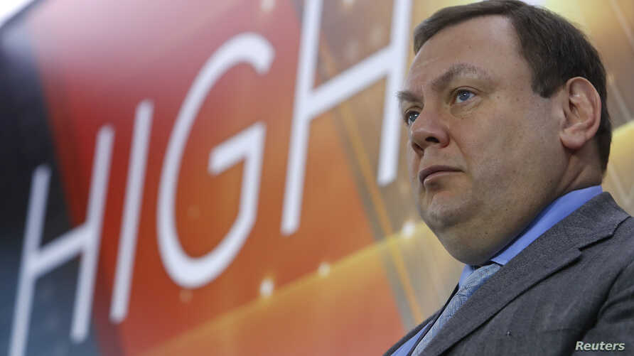 FILE - Mikhail Fridman, chairman of the supervisory board of the Alfa Group Consortium, attends a ceremony at the Moscow Exchange in Moscow, Russia Feb. 1, 2018. Fridman, Alfa Bank's founder, has an estimated net worth of $14 billion, according toF...