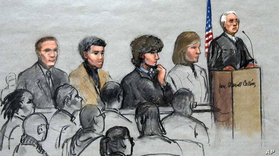 In this courtroom sketch, Boston Marathon bombing suspect Dzhokhar Tsarnaev, third from right, is depicted with his lawyers and U.S. District Judge George O'Toole Jr. at the federal courthouse in Boston Jan. 6, 2015.