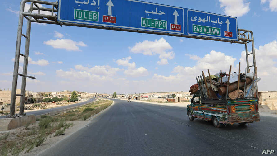 Residents of Idlib province flee toward the Syrian Turkish border on Sept. 10, 2018.