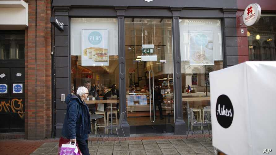 FILE- In this March 26, 2015, photo, the store front of Ashers Baking Company is seen in Belfast, Northern Ireland.  On Monday, Ashers lost its appeal against a 2015 court ruling that the business discriminated against a homosexual customer by refusi