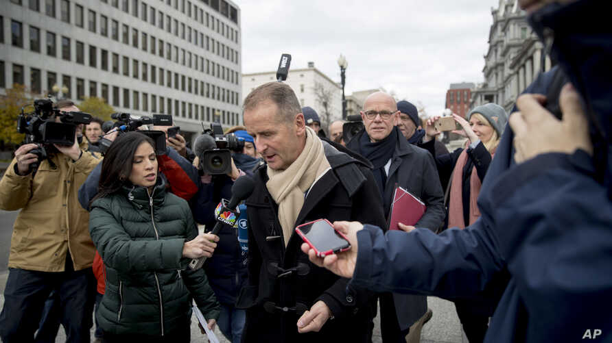 Volkswagen CEO Herbert Diess, center, accompanied by chief lobbyist Thomas Steg, center right, speaks to reporters as they arrive for a meeting with Trump administration officials at the White House complex in Washington, Dec. 4, 2018.