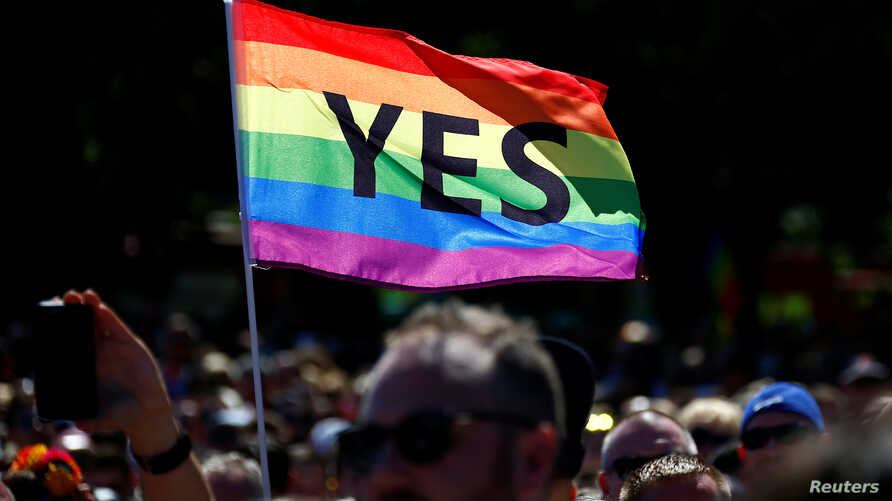 "Supporters of the ""Yes"" vote for marriage equality celebrate, Nov. 15, 2017, after it was announced the majority of Australians support same-sex marriage in a national survey. Saturday the first two couples wed."