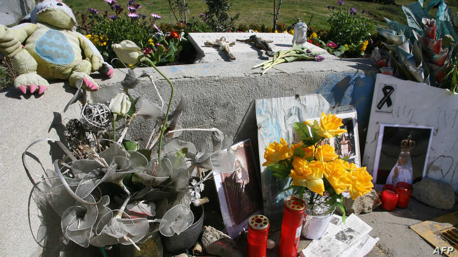 Flowers and candles are placed in front of the Santa Eugenia train Station near Madrid, March 10, 2006, in memory of the victims who died in the March 11, 2004 attacks in the Spanish capital. Ten bombs went off on four trains 11 March 2004, killing 1