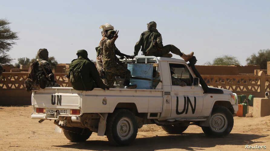 Chadian U.N. peacekeepers gesture as they patrol in Aguelhok, Mali, Jan. 24, 2014.