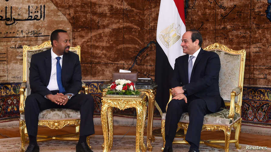 Egyptian President Abdel Fattah al-Sissi, right, meets with  Ethiopian Prime Minister Abiy Ahmed at the Ittihadiya presidential palace in Cairo, Egypt, June 10, 2018.