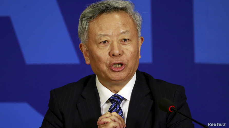 FILE - President of Asian Infrastructure Investment Bank (AIIB) Jin Liqun speaks at a news conference in Beijing.