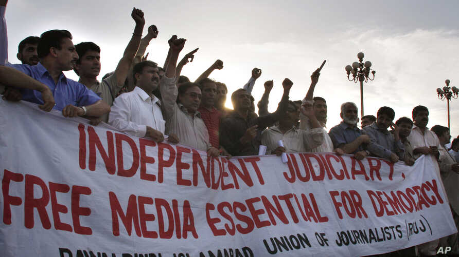 FILE - Pakistani journalists and members of civil society chant slogans during a rally to mark the World Press Freedom Day, May 3, 2008, in Islamabad, Pakistan.