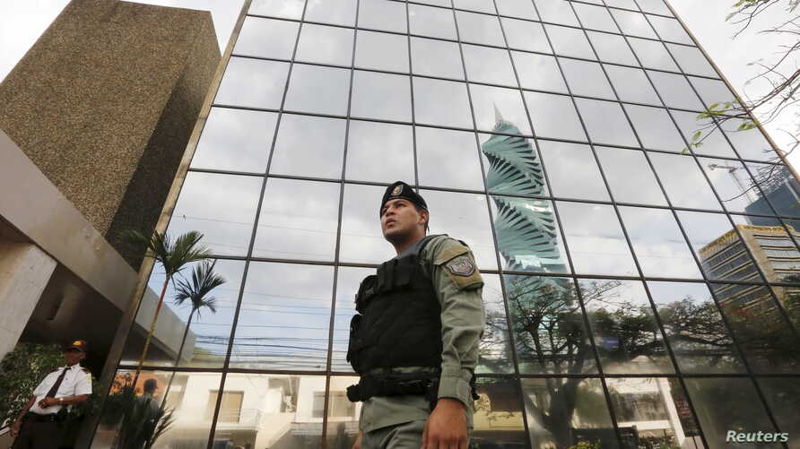 A police officer stands guard outside the Mossack Fonseca law firm office in Panama City, April 12, 2016.