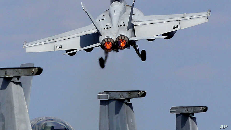"""A U.S. Navy F/A-18 Super Hornet takes off from the flight deck of the USS George Washington during """"Keen Sword"""" U.S.-Japan joint military exercise over the Pacific Ocean, Dec. 10, 2010."""