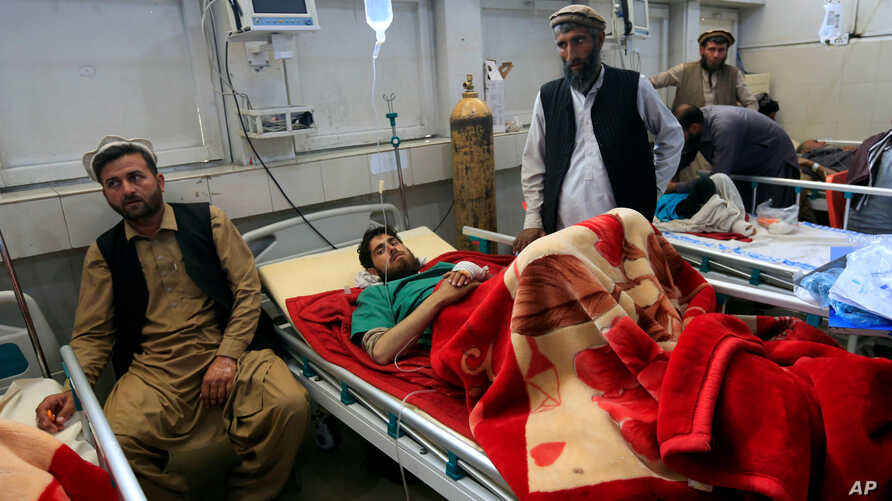 An injured man receives treatment in a hospital, after twin explosions in Jalalabad, Afghanistan, April 6, 2019.