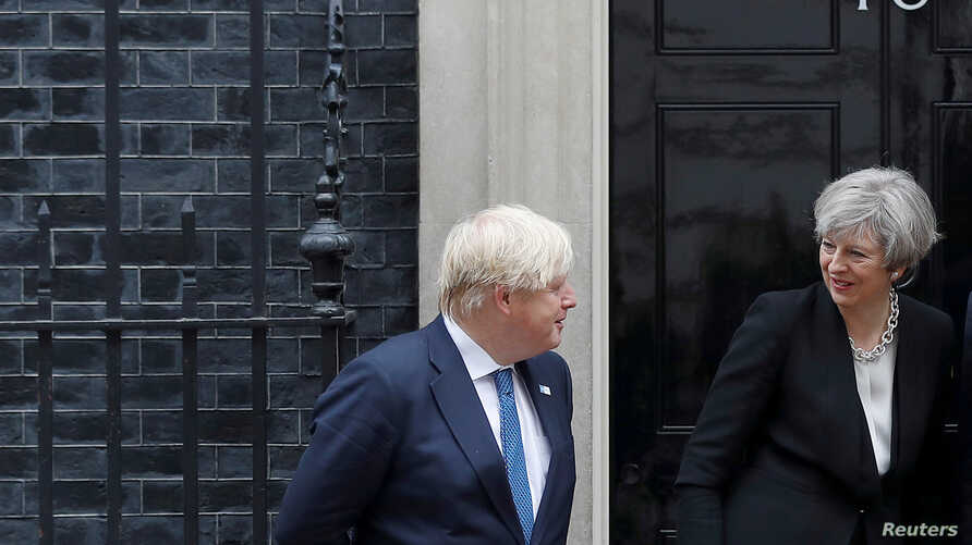 Britain's Prime Minister Theresa May alongside Foreign Secretary Boris Johnson, greets Ethiopia's Prime Minister Hailemariam Desalegn (not pictured) in Downing street ahead of the Somalia Conference, in London, May 11, 2017.