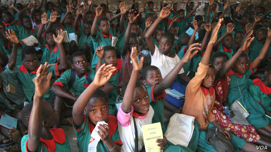School children participate in a class on malaria and how to protect themselves, Malawi.