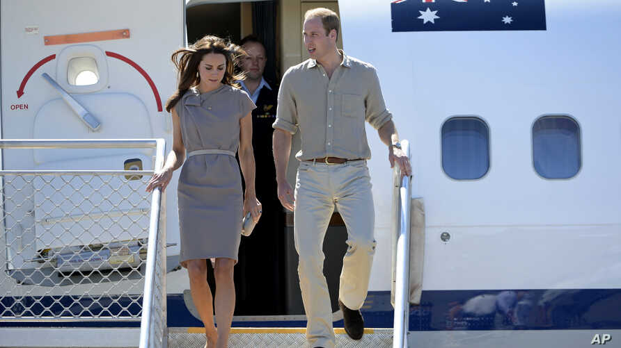 FILE - Britain's Prince William and his wife Catherine, the Duchess of Cambridge, arrive at Ayers Rock Airport in Yulara, central Australia, April 22, 2014.