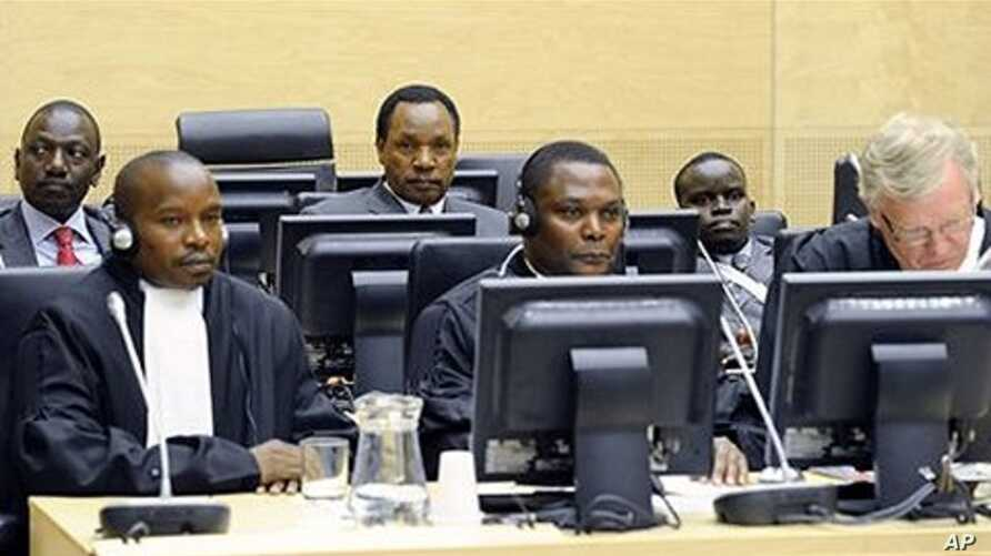 Back row, former Kenyan Education Minister Ruto, left, former Kenyan Minister of Industrialization Kosgey, center, and Kenyan broadcaster Sang, right, appear at the International Criminal Court in The Hague, Netherlands, April 7, 2011