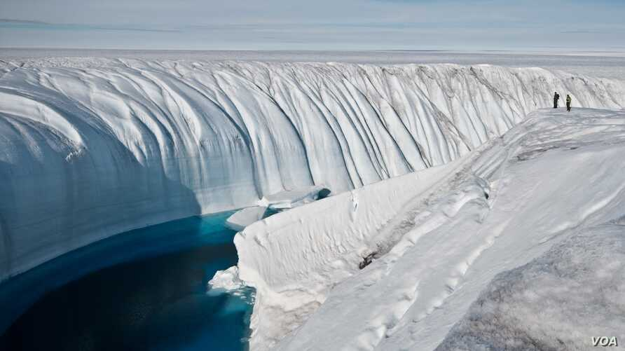 Surface melt water rushes along the surface of the Greenland Ice Sheet through a supra-glacial stream channel. [Image courtesy of Ian Joughin]