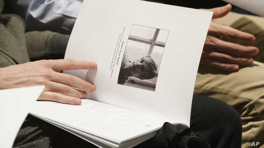 "Mourners hold programs with the image of Matthew Shepard during a ""Thanksgiving and Remembrance of Matthew Shepard"" service at Washington National Cathedral in Washington, Oct. 26, 2018. The ashes of Matthew Shepard, whose brutal murder in the 1990s"