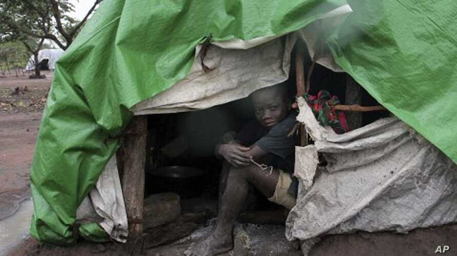 An internally displaced boy takes shelter from the rain at Kabo camp in northern Central African Republic. (File Photo)