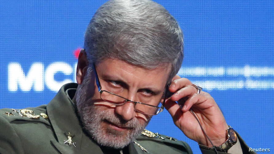 FILE - Iranian Defense Minister Amir Hatami adjusts a headphone during the annual Moscow Conference on International Security in Moscow, April 4, 2018.
