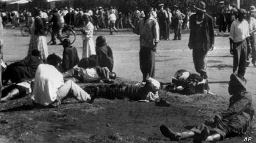 Wounded people lie in the street, 21 March 1960 in Sharpeville, near Vereeniging, where at least 180 black Africans, most of them women and children, were injured and 69 killed, when South African police opened fire on black protestors.