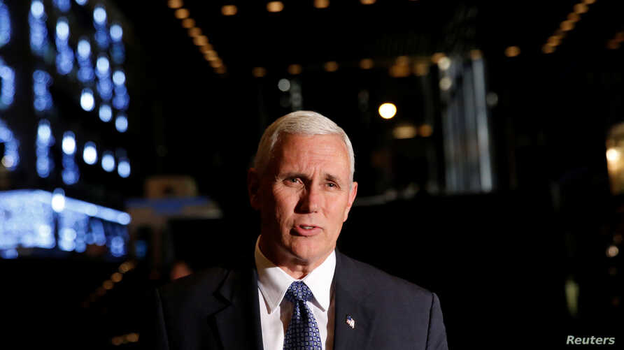 U.S. Vice President-elect Mike Pence, who leads the Trump transition team, speaks to the media outside Trump Tower in New York U.S., Dec. 5, 2016.