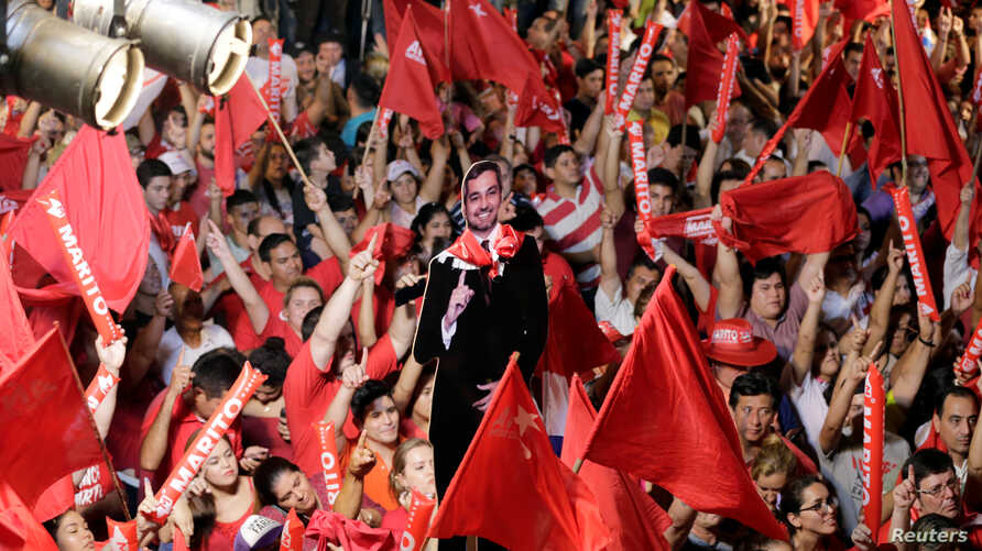 Supporters of Paraguay's newly-elected President Mario Abdo Benitez of the Colorado Party celebrate in Asuncion, Paraguay, April 22, 2018.