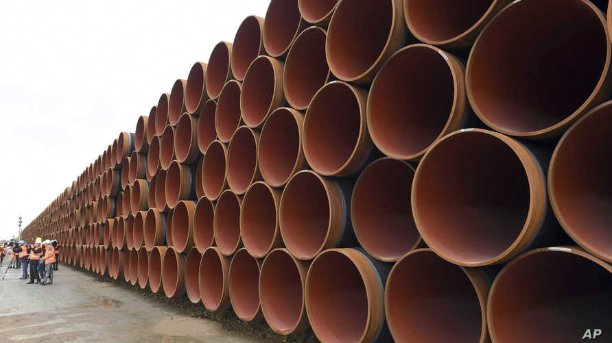 FILE - Steel pipes for the North Stream 2 pipeline are stacked in Mukran harbor in Sassnitz, Germany, May 8, 2017.