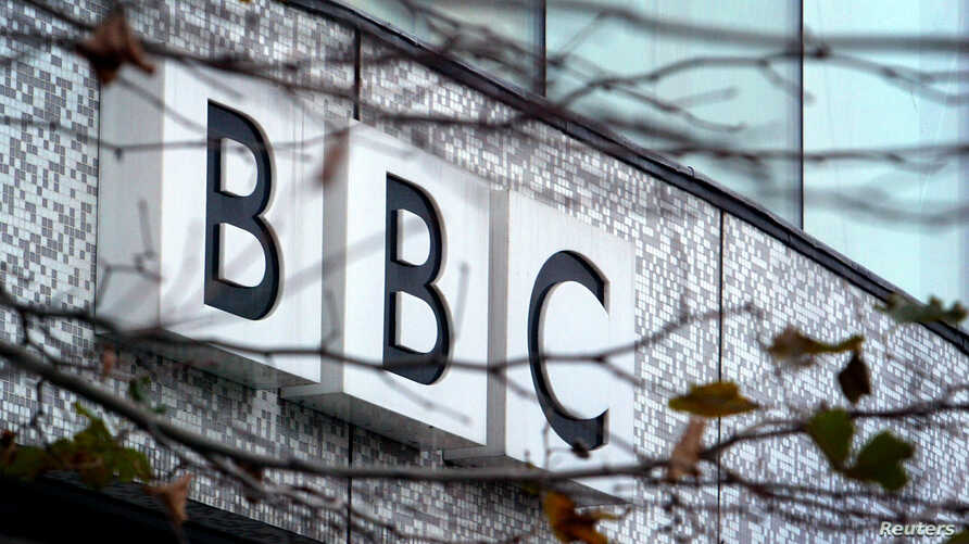 A BBC logo is seen at the company's main offices, in west London, on the day the organisation announced one of the biggest shake-ups in its 82-year history, December 7, 2004. Britain's venerable public broadcaster plans to axe at least 10 percent of