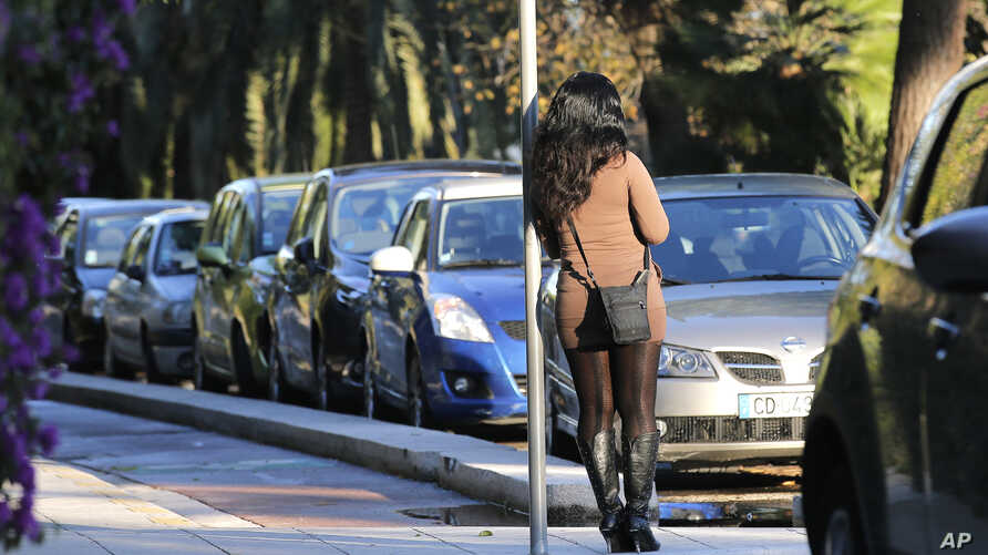 FILE - A prostitute waits for a client in a street of Nice southern France, Nov. 21, 2013.France's government is pushing one of Europe's toughest laws against prostitution and sex trafficking, and other countries are watching closely.