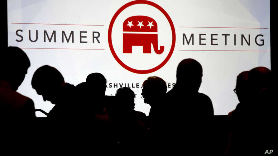 People talk before the start of the meeting of the standing committee on rules at the Republican National Committee summer meeting in Nashville, Tenn., Aug. 24, 2017.