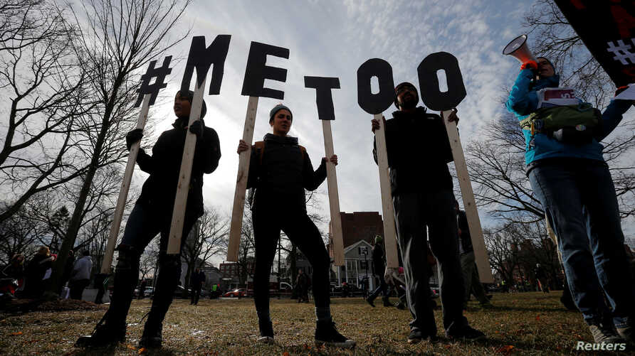 """Demonstrators spell out """"#MeToo"""" during the local second annual Women's March in Cambridge, Mass., Jan. 20, 2018."""