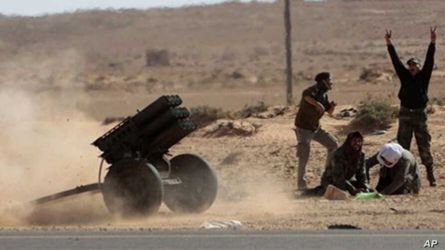 Libyan rebels fire multiple launcher rockets during a fight against pro-Gadhafi fighters near the town of Bin-Jawad, eastern Libya, Sunday, March 6, 2011.