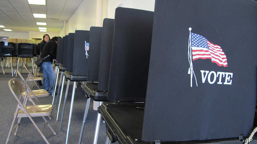 FILE - Members of the Native American Voters Alliance mark their ballots at an early voting center in Albuquerque, N.M., Oct. 26, 2012.  (AP Photo/Susan Montoya Bryan)