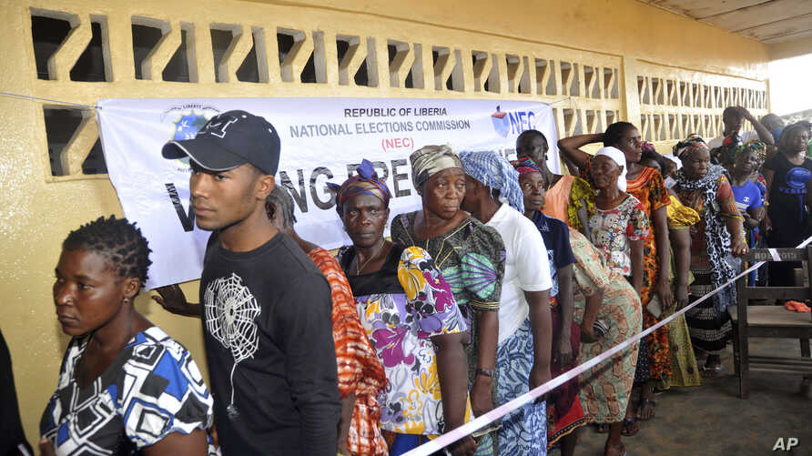People wait to cast their votes during a Presidential election in Monrovia, Liberia, Oct. 10, 2017.
