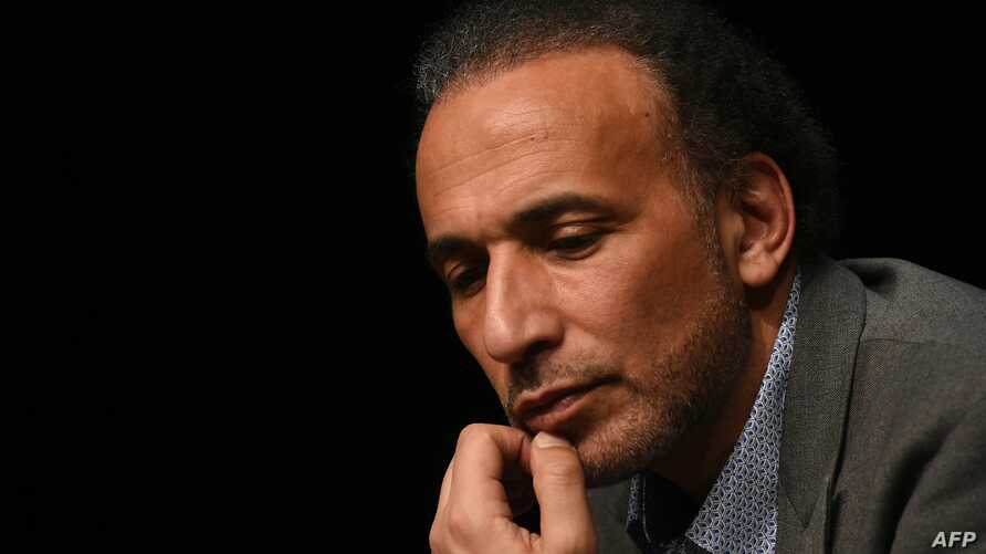 """FILE - This file photo taken on March 26, 2016 shows Swiss Islamologist Tariq Ramadan taking part in a conference on the theme """"Live together"""" in Bordeaux."""