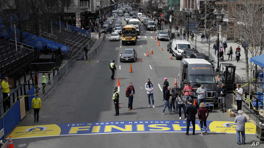 The newly applied Boston Marathon finish line rests on Boylston St., April 13, 2017, in Boston. The finish line is made from an adhesive decal that covers a painted version that is left in place throughout the year. The 121st Boston Marathon is to be