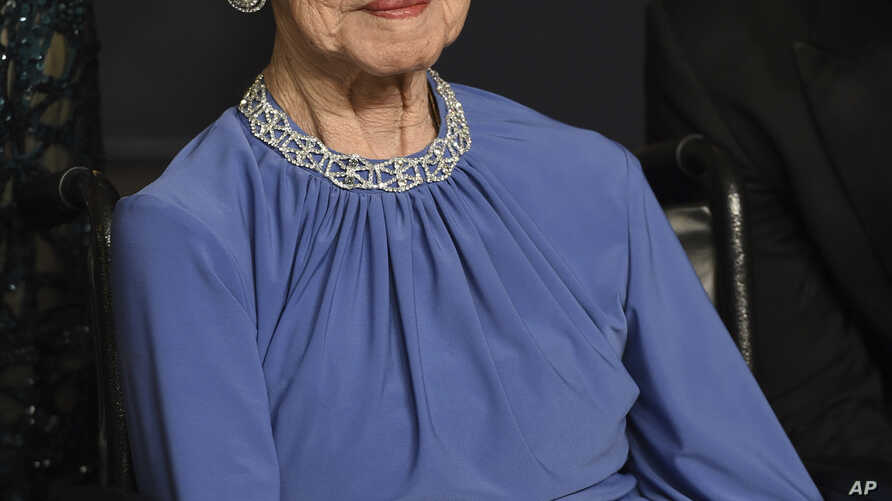 """FILE - Former NASA mathematician Katherine Johnson, the inspiration for the film """"Hidden Figures,"""" poses in the press room at the Oscars at the Dolby Theatre in Los Angeles, California, Feb. 26, 2017."""