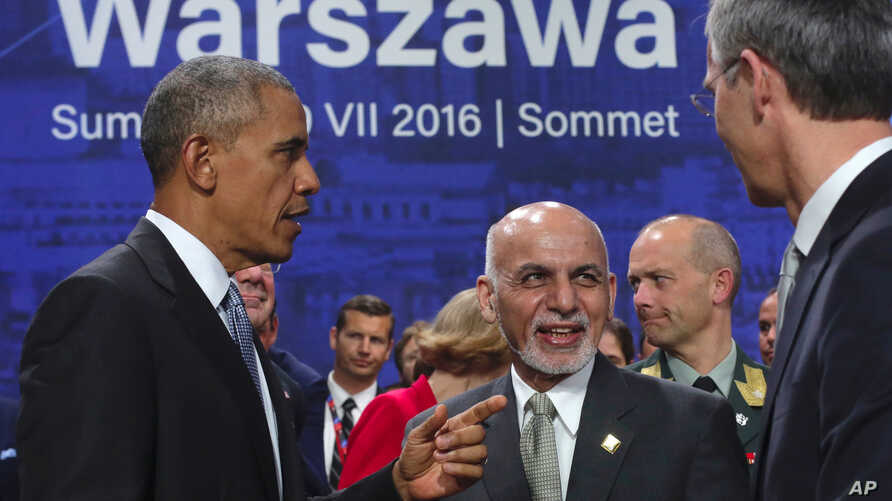 Afghan President Ashraf Ghani, center, speaks with U.S. President Barack Obama and NATO Secretary General Jens Stoltenberg at the NATO summit in Warsaw, Poland, July 9, 2016.